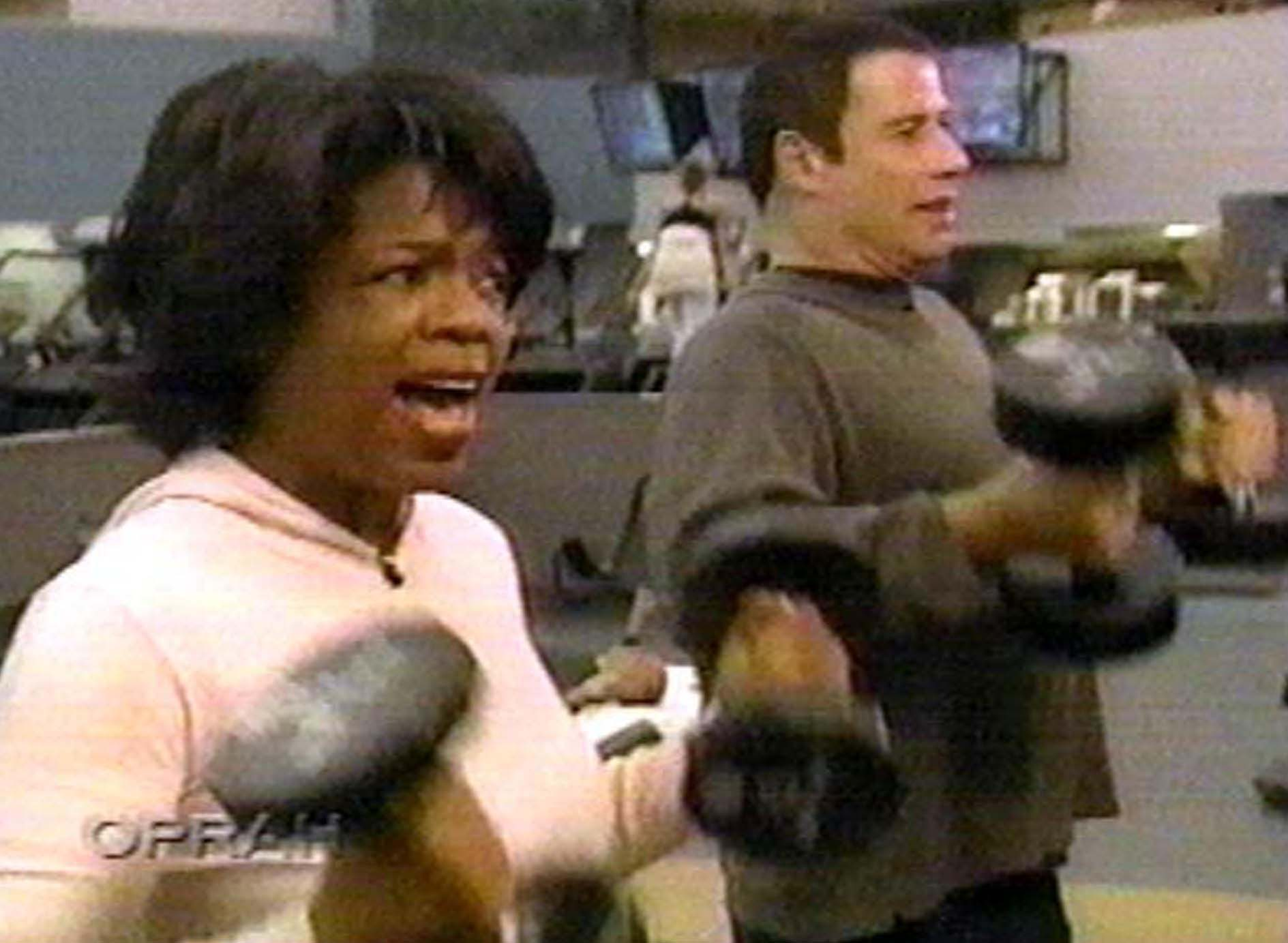 Oprah Winfrey with John Travolta in 1990