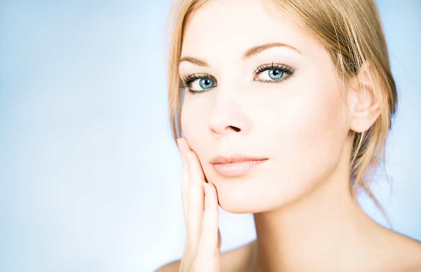 woman admiring her healthy, sensitive skin