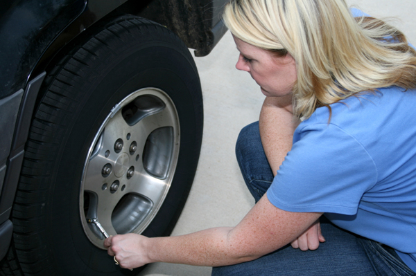 woman-checking-air-pressure-in-tires