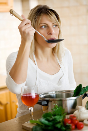Woman cooking with wine