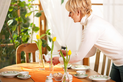 Woman setting up for tea party