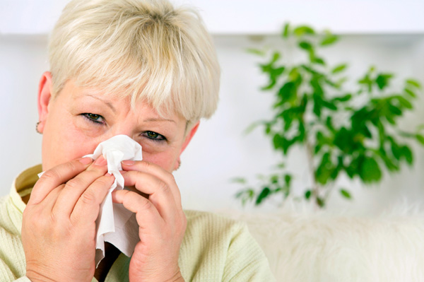 Woman with allergies at home