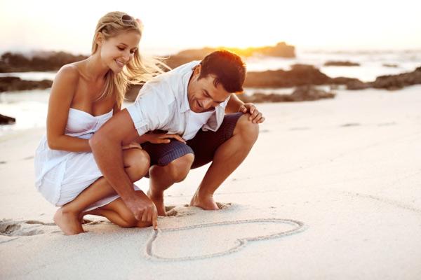Newlywed couple on the beach for honeymoon