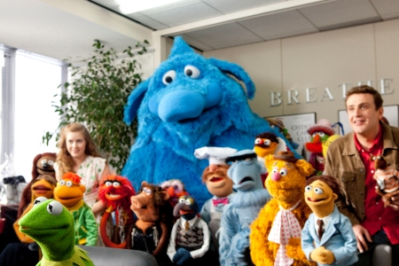 Amy Adams and Jason Segel with quite a few Muppets