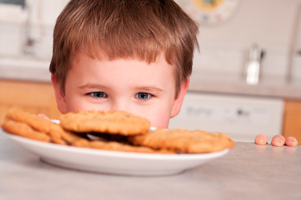 Boy looking at cookies