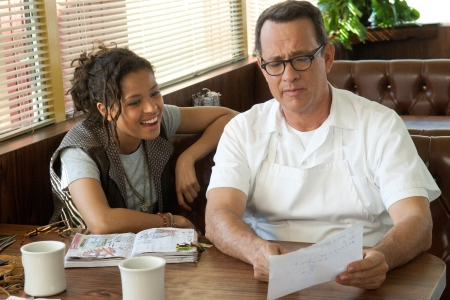 Gugu and Tom Hanks go over a scene on the set of Larry Crowne