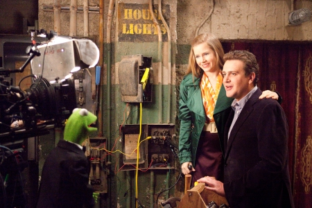 Kermit, Amy Adams and Jason Segel on the set of The Muppets
