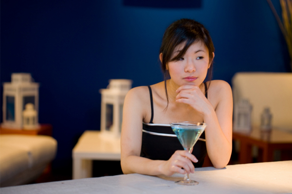 Lonely woman at bar