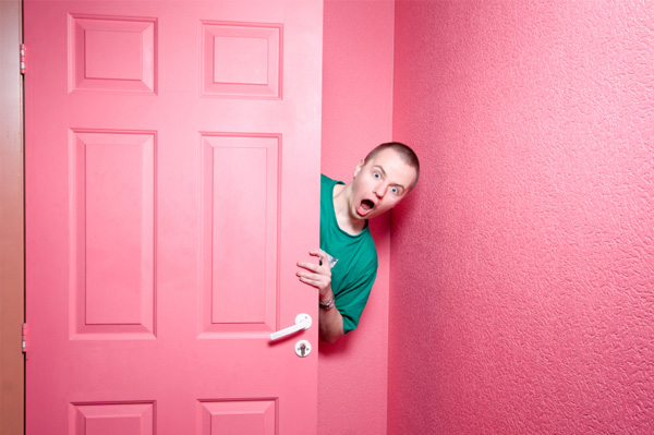 Man in pink room