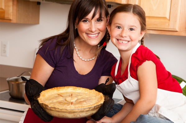 Mom and daughter making pie