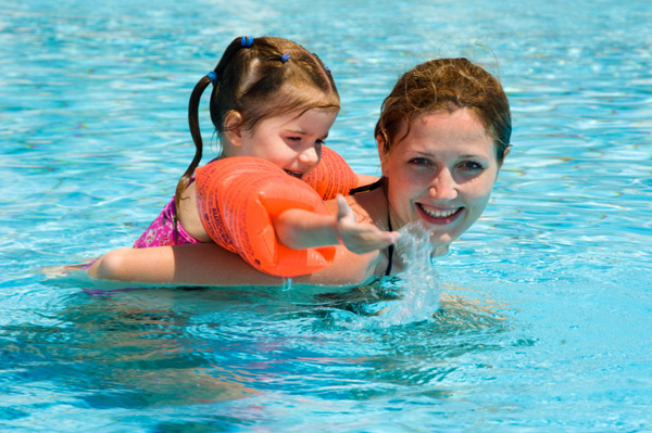 Mom and daughter in pool
