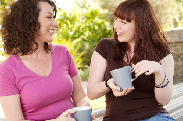 Mom and teen talking over coffee