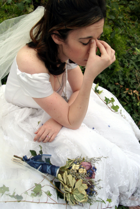 bride stressed out in wedding dress