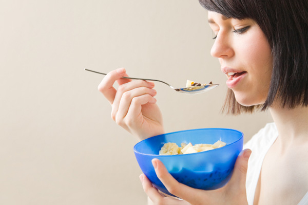 Woman eating cereal on the go