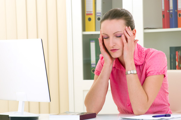 Woman falling asleep at desk