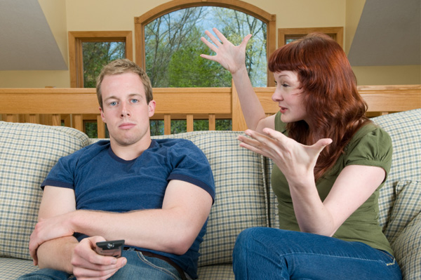 woman nagging husband on couch 10 Things Guys Wish Women Knew About Men
