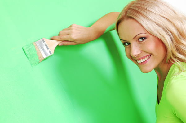 Woman painting wall vibrant color