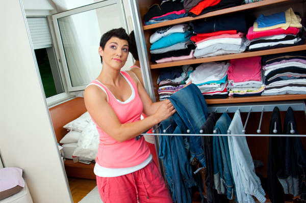 Woman sorting through closet