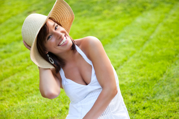 Woman wearing summer hat