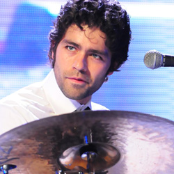 Adrian Grenier playing drums