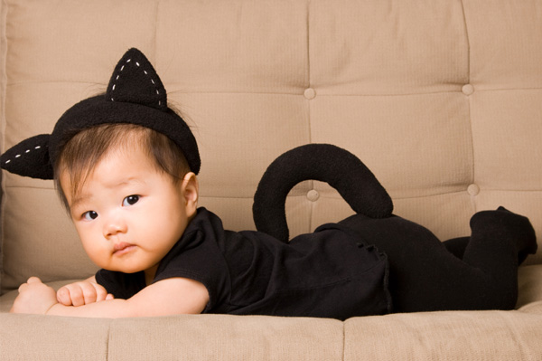 Baby in cat costume