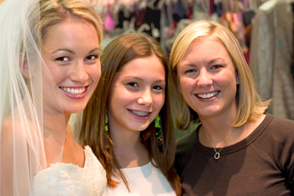 Bride and sisters at bridal shop