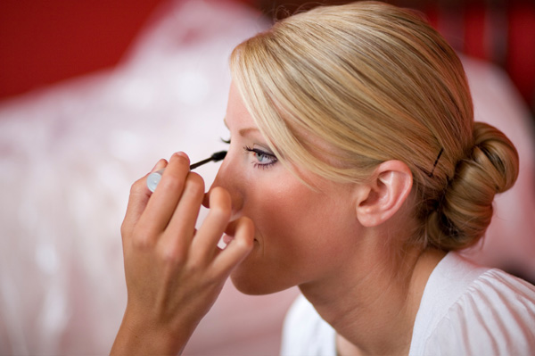 Bride applying mascara