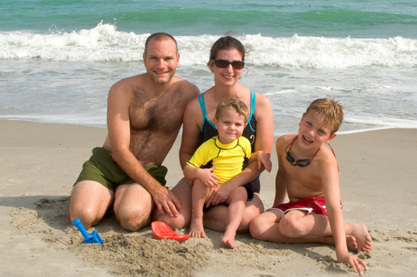 Family with toddler at beach