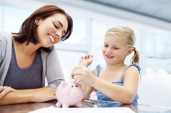 Mom and daughter and piggy bank