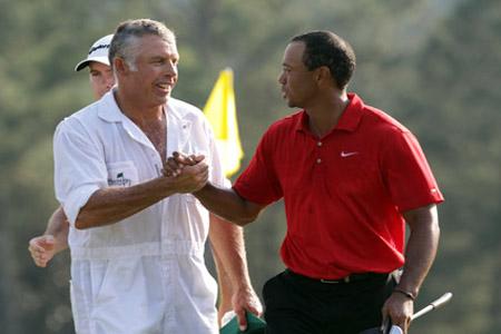 Tiger Woods fires his caddie