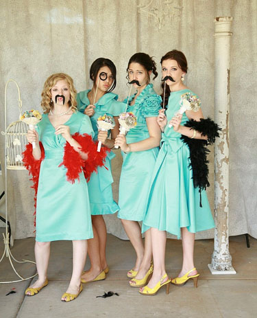 Unconventional wedding photo booth with props