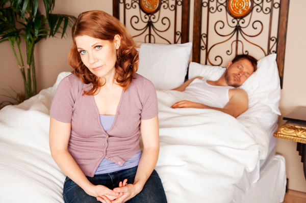 Unhappy couple in bed