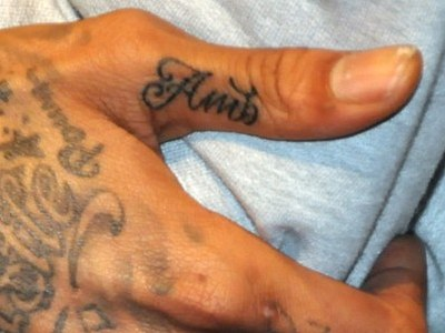 Wiz thumb tattoo