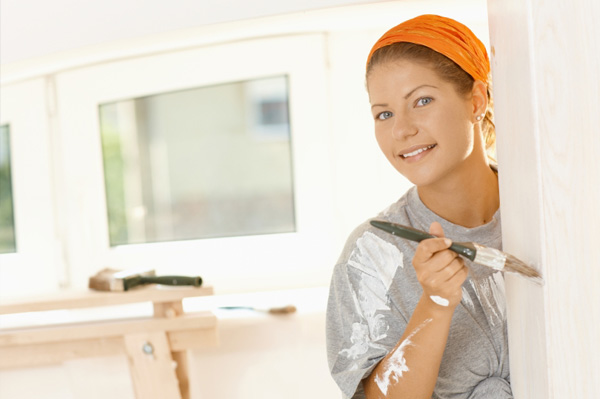 Woman painting with low voc paint