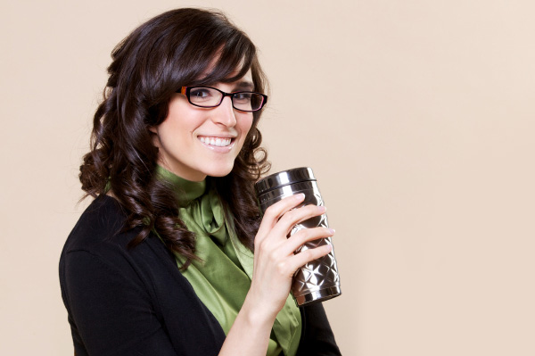 Woman with travel coffee mug