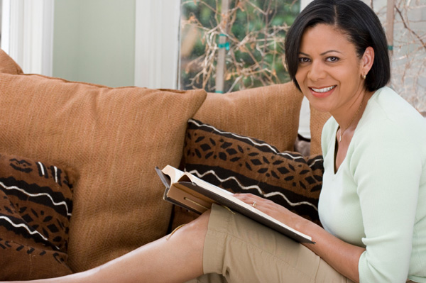 Woman writing in journal at home