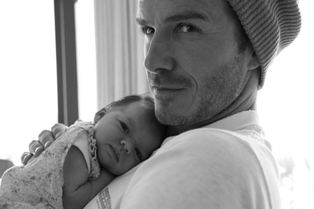 David Beckham snuggles Harper Seven