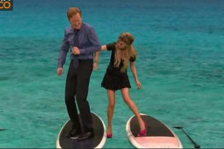 Marisa Miller gives Conan a spanking