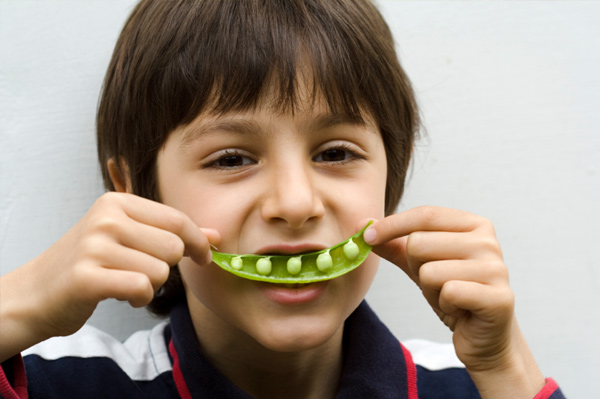Boy with pea pod