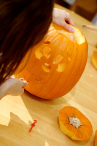 Girl carving pumpkin