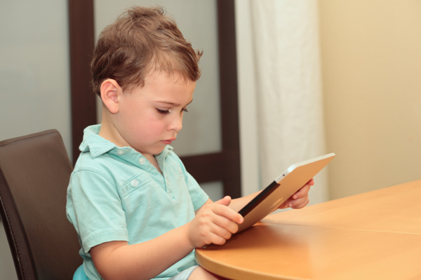 Little boy on digital tablet