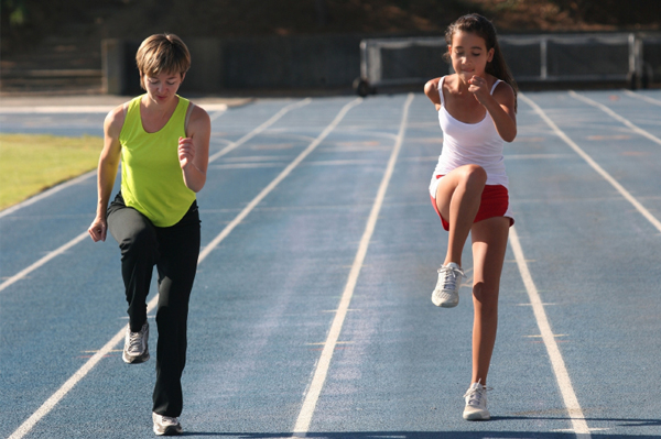 Mom and tween daughter running track