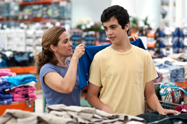 Mom buying t-shirts at discount store