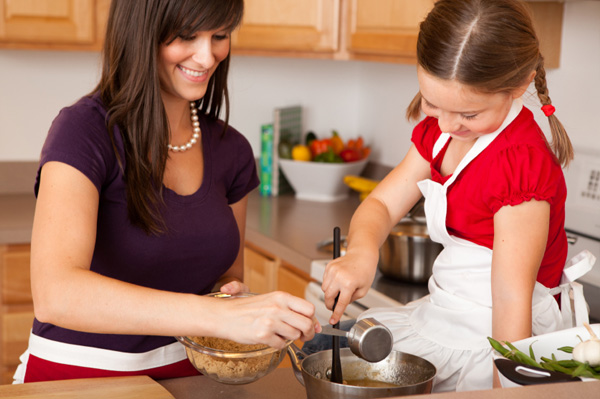 Mom cooking healthy meal with daughter