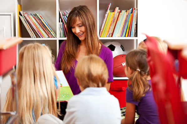 Mom reading story to classroom