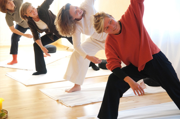 Woman in group yoga class