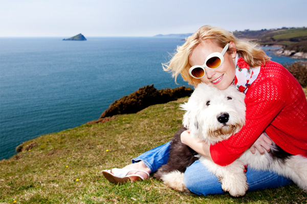 Woman with sheepdog on vacation