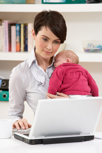 Working mom reading e-mail