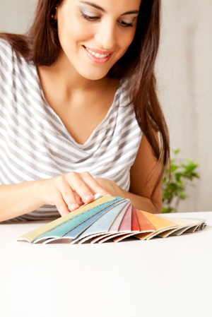 Woman selecting color palatte for home