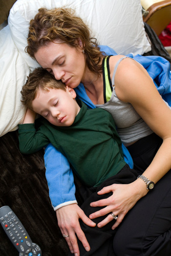Working mom napping with son
